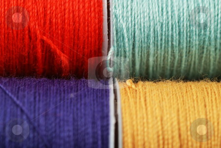 Colorful threads stock photo, Colorful spools of multi colored threads for sewing and knitting by Albert Lozano