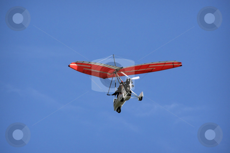 Hang-glider stock photo, Foot launched aeroplane on the sky by Sergej Razvodovskij