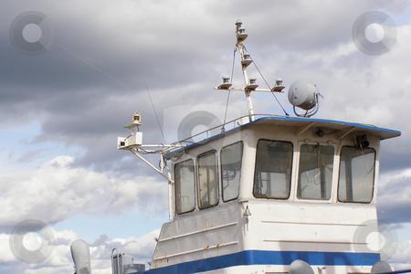 Wheelhouse stock photo, Pilot-house of little ship on a background sky with clouds by Sergej Razvodovskij