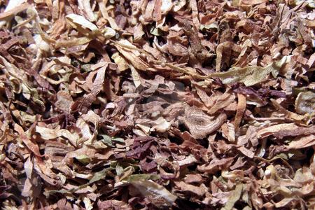 Tobacco stock photo, Tobacco spilled on a table by Sergej Razvodovskij