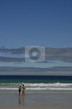 Beach stock photo, Young couple at the beach in the water by Rui Vale de Sousa