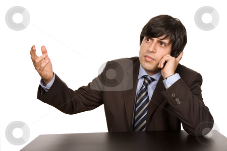 Calling stock photo, Young worried business man, on a desk by Rui Vale de Sousa