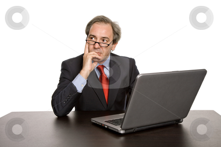 Thinking stock photo, Mature business man working with his laptop by Rui Vale de Sousa