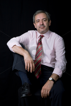 Standing stock photo, Mature business man portrait on black background by Rui Vale de Sousa