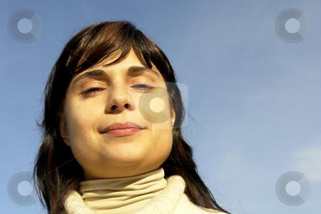 Woman stock photo, Young woman close up portrait enjoying the sun by Rui Vale de Sousa