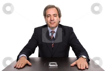 Desk stock photo, Mature business man on a desk, isolated on white by Rui Vale de Sousa