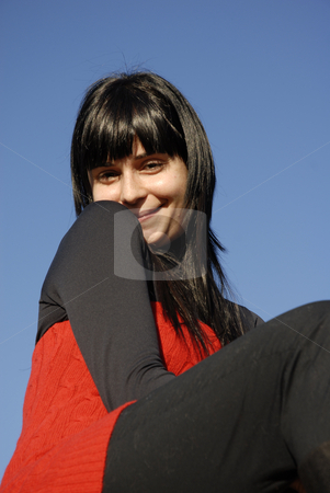Flirt stock photo, Casual latin girl outdoors with the sky in the background by Rui Vale de Sousa
