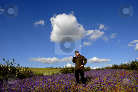 Pensive stock photo, Young pensive man among flowers and the sky by Rui Vale de Sousa