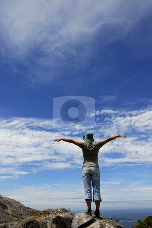 Women stock photo, Happy woman with arms wide open at the coast by Rui Vale de Sousa