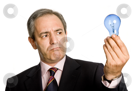 Ideia stock photo, Mature business man with a lamp isolated on white by Rui Vale de Sousa
