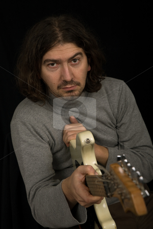 Rocker stock photo, Young rocker in studio picture, closeup portrait by Rui Vale de Sousa