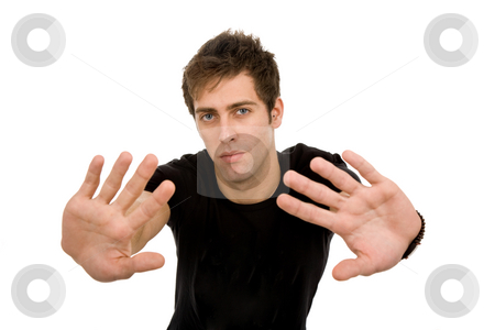 Halt stock photo, Young casual man making stop with his hands by Rui Vale de Sousa