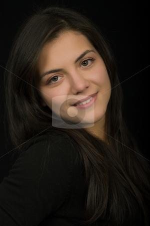Brunette stock photo, Young beautiful brunette portrait against black background by Rui Vale de Sousa