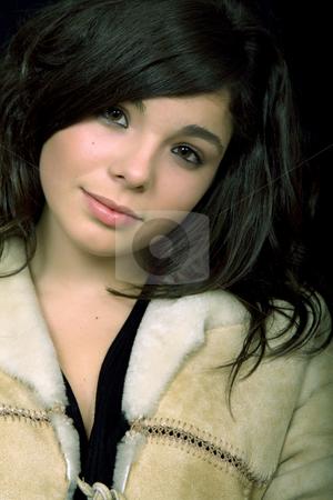 Sad girl stock photo, Young beautiful brunette portrait against black background by Rui Vale de Sousa