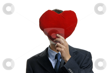 Heart stock photo, Man holding covering his face with a red heart by Rui Vale de Sousa