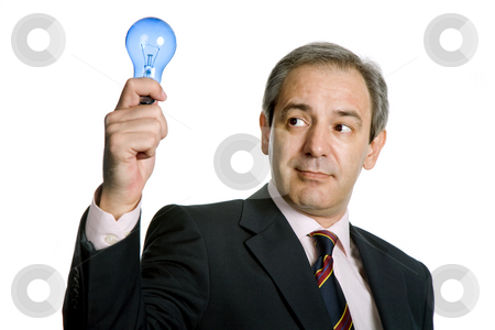 Idea stock photo, Mature business man with a lamp isolated on white by Rui Vale de Sousa