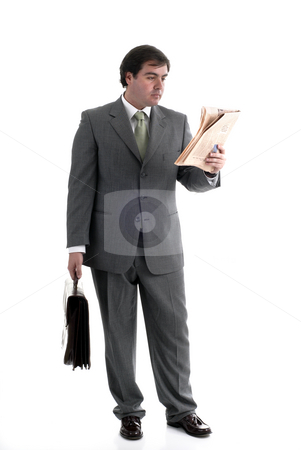 Read stock photo, Young businessman with a suitcase and a newspaper by Rui Vale de Sousa