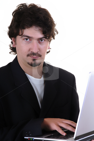 Working stock photo, Young business man portrait with personal computer by Rui Vale de Sousa