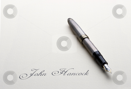 John Hancock stock photo, A fountain pen sits on a blank sheet of paper with only a signature by Matt Baker
