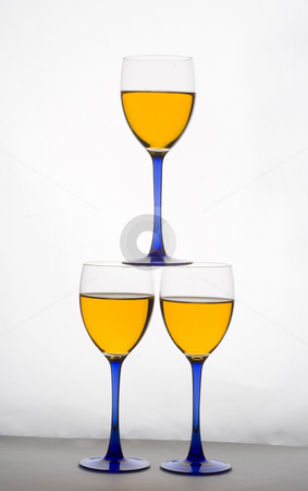 Stacked wine glasses stock photo, Three wine glasses stacked on top of each other by Matt Baker