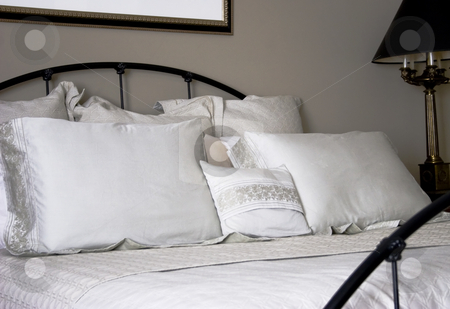 Elegant Bed stock photo, A closeup of an elegantly made bed by Matt Baker