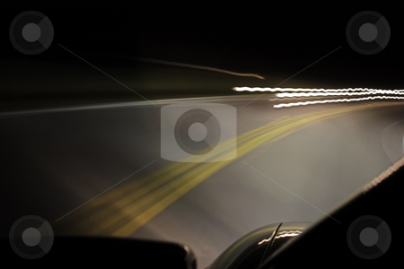 On comming stock photo, An on comming car at night by Matt Baker