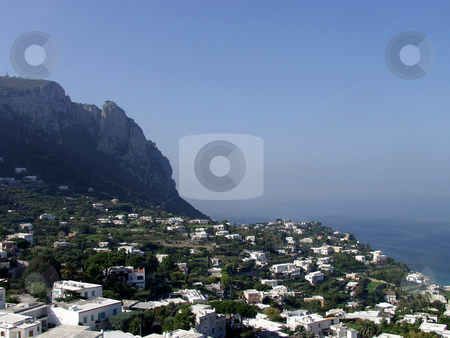 Town by the sea stock photo, A small town sits between a cliff and the sea by Matt Baker