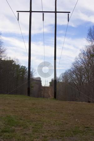 Power Lines stock photo, A set of power lines running up a hill by Matt Baker