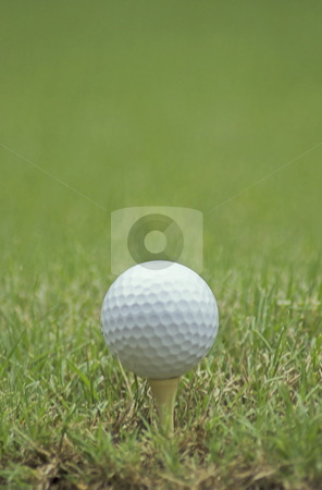 Golf ball and tee stock photo, A golf ball sits on a tee ready to be hit by Matt Baker