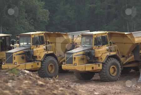 Construction stock photo, Construction equipment excavating land by Matt Baker