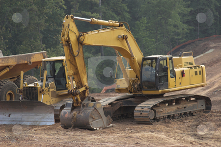 Construction stock photo, Construction equipment excavating land by Matt Baker