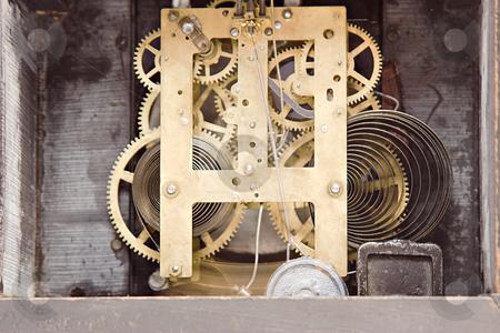 Gears of a clock stock photo, The inside of a mantel clock by Matt Baker