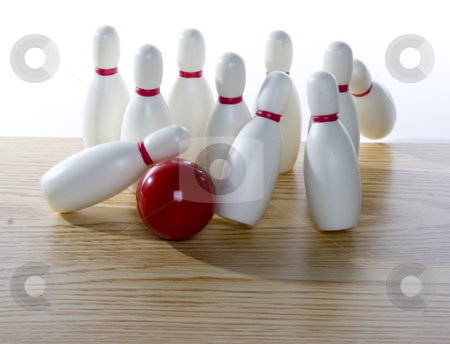 Knocking down pins stock photo, A bowling ball in action knocks down pins by Matt Baker