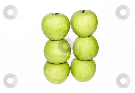 Stacks of apples stock photo, Two stacks of apples sit next to each other by Matt Baker