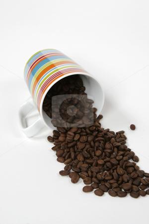 Coffee mug and beans stock photo, A coffee mug full of beans by Matt Baker
