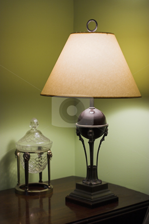 Table lamp and candy dish stock photo, Table lamp and candy dish by Matt Baker