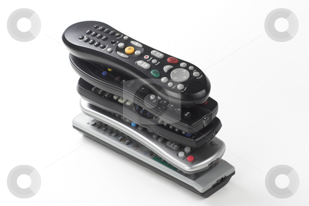 Remote Controler stock photo, A stack of remote controls sits in a pile by Matt Baker