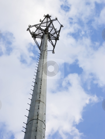 Cell Tower stock photo, A cell tower against a partly cloudy sky by Matt Baker