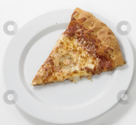 Pizza slice stock photo, A slice of pizza sits on a plate by Matt Baker