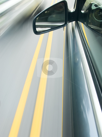 Speeding car stock photo, The view outside from a moving car by Matt Baker