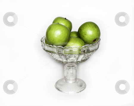 Bowl of apples stock photo, A crystal bowl sits full of apples by Matt Baker