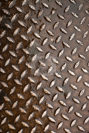 Rusty Diamond Plate stock photo, Closeup of real diamond plate material.  Wet and rusty.  This is a photo not an illustration. by Todd Arena