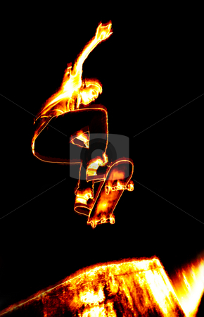 Fiery Skateboarder stock photo, Illustration of a skateboarder performing his tricks in fiery flames. by Todd Arena