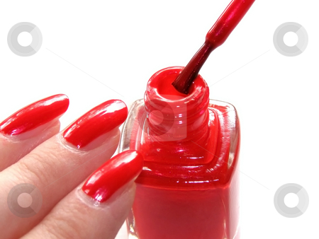 Manicure stock photo, Woman's nails with manicure and vial of red color nail polish by Sergej Razvodovskij