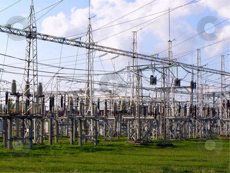 Electricity stock photo, Power station equipment under cloudy blue sky by Sergej Razvodovskij