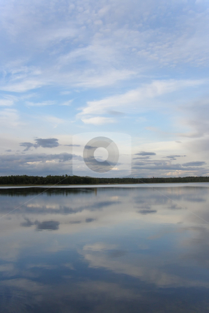 Lake and sky stock photo, Blue sky and it reflection in the smooth water of lake by Sergej Razvodovskij