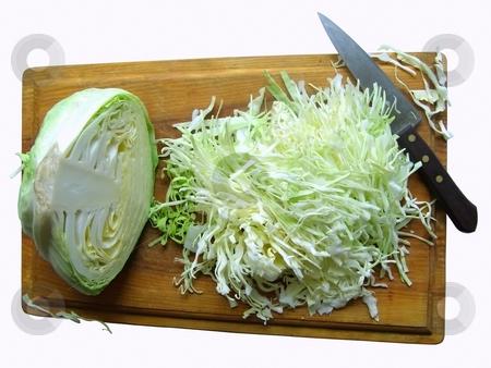 Cabbage on the breadboard stock photo, Half head of cabbage,knife and choped cabbage on the breadboard by Sergej Razvodovskij