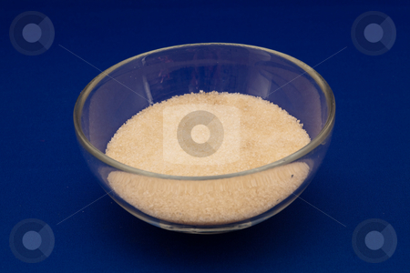 Bowl of brown sugar stock photo, Brown sugar is a sucrose sugar product with a distinctive brown color due to the presence of molasses. by Mariusz Jurgielewicz