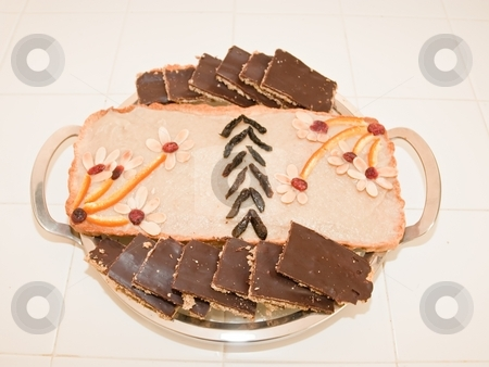 Mazurek stock photo, Polish Easter Cake. A softer version of shortbread, topped with almonds and cut into serving-sized squares. There is a variety of traditional toppings. Mazurek is usually colourfully iced and decorated with jam, nuts and raisins. by Mariusz Jurgielewicz