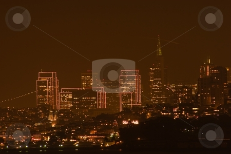 San Francisco skyline at night stock photo, San Francisco is a popular international tourist destination renowned for its summer fog, steep rolling hills, eclectic mix of Victorian and modern architecture and its famous landmarks, including the Golden Gate Bridge, the cable cars, and Chinatown. by Mariusz Jurgielewicz